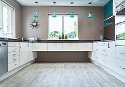 Grey Oak wood effect vinyl wood flooring in a kitchen (Unnatural Wood - UW5002)
