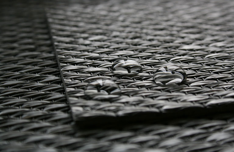 water drops on a sample of Unnatural Flooring